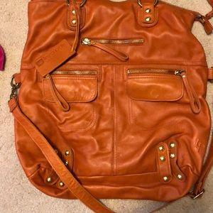 Linea Pelle Bags - Orange linea pelle bag.